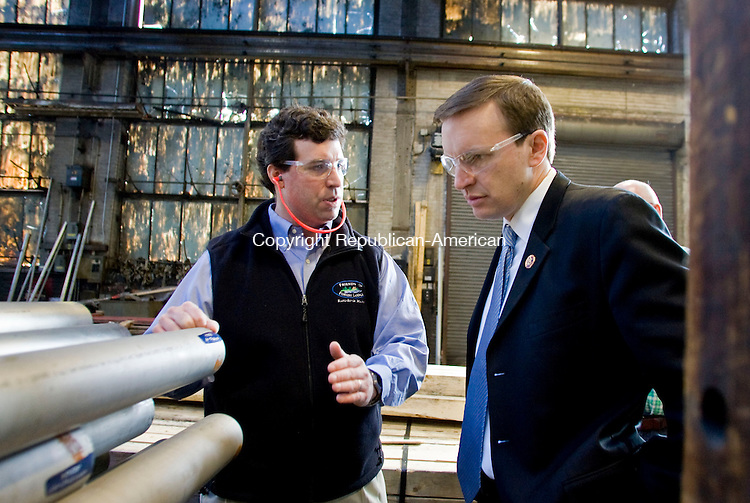 WATERBURY, CT - 02 MARCH 2010 -030210JT08--<br /> John Barto, president of Ansonia Copper and Brass, speaks to U. S. Rep. Chris Murphy (D-5th) as Murphy takes a tour of the Waterbury facility on Tuesday morning.<br /> Josalee Thrift Republican-American