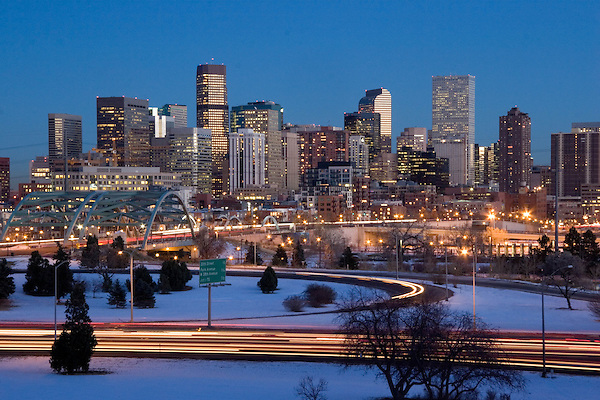 Downtown Skyline in winter, with Interstate 25 and car traffic, Denver, Colorado. .  John offers private photo tours in Denver, Boulder and throughout Colorado. Year-round Colorado photo tours.