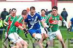 Paul O Donoghue of St. Marys under pressure from Eanna O'Connor and Sean Fogarty of St. Michaels/Foilmore during the South Kerry semi final in Valentia on Sunday.