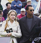 PAYNE STEWART HONOURED IN IRELAND 12-7-00<br /><br />© Don MacMonagle, Killarney Ireland 353+87+2563610<br /><br />Clutching a photograph of Payne Stewart Tiger Woods and his girlfriend Joanna Jagoda arrive for the Payner Stewart Memorial service at Waterville Golf Club , Ireland .<br />Picture by Don MacMonagle