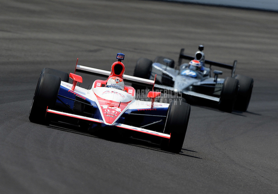 May 30, 2010; Indianapolis, IN, USA; IndyCar Series driver Vitor Meira (14) leads Raphael Matos during the Indianapolis 500 at the Indianapolis Motor Speedway. Mandatory Credit: Mark J. Rebilas-