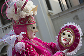 Venice, Italy, 8 February 2015. Woman in a pink costume looking at her reflection in a mirror. People wear traditional masks and costumes to celebrate the 2015 Carnival in Venice. carnivalpix/Alamy Live News