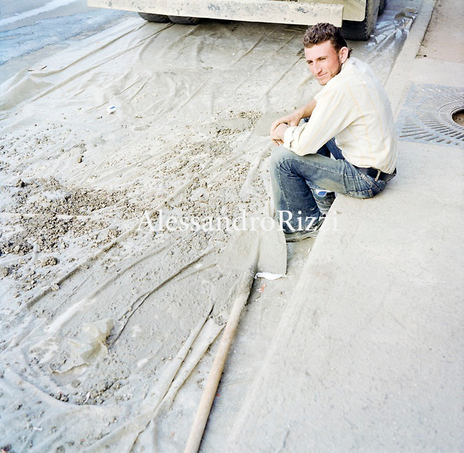 A man sitting near a Building Site