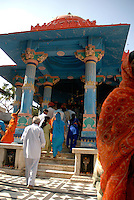 The pillared outdoor hall of the Brahma Temple. Pushkar is home to one of the few temples dedicated to Brahma the Creator in all of India. It is believed that Pushkar Lake was created when a lotus petal fell from the hand of Brahma and dropped into the valley surrounded by the Aravali Hills.