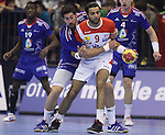 12.01.2013 Granollers, Spain. IHF men's world championship, prelimanary round. Picture show Amine Bannour and Nikola Karabatic in action during game between France vs Tunisia at Palau d'esports de Granollers