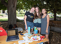 Occidental College students browse club tables at the Involvement Fair in the Academic Quad, Sept. 5, 2019. The annual event is an opportunity for students to learn about and join student-run clubs that offer a wide variety of interests.<br /> (Photo by Marc Campos, Occidental College Photographer)