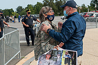 Susan Zeier, of Sandusky Ohio, whose son in-law Army SFC Heath Robinson died from complications due to exposure in burn pits, gets a hug and is comforted by Retired NYFD firefighter Joe McKay, following a press conference regarding legislation to assist veterans exposed to burn pits, outside the US Capitol in Washington, DC., Tuesday, September 15, 2020. <br /> Credit: Rod Lamkey / CNP /MediaPunch