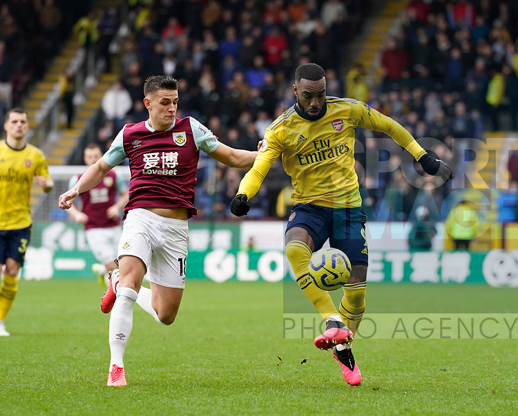 Ashley Westwood of Burnley challenges Alexandre Lacazette of Arsenal during the Premier League match at Turf Moor, Burnley. Picture date: 2nd February 2020. Picture credit should read: Andrew Yates/Sportimage