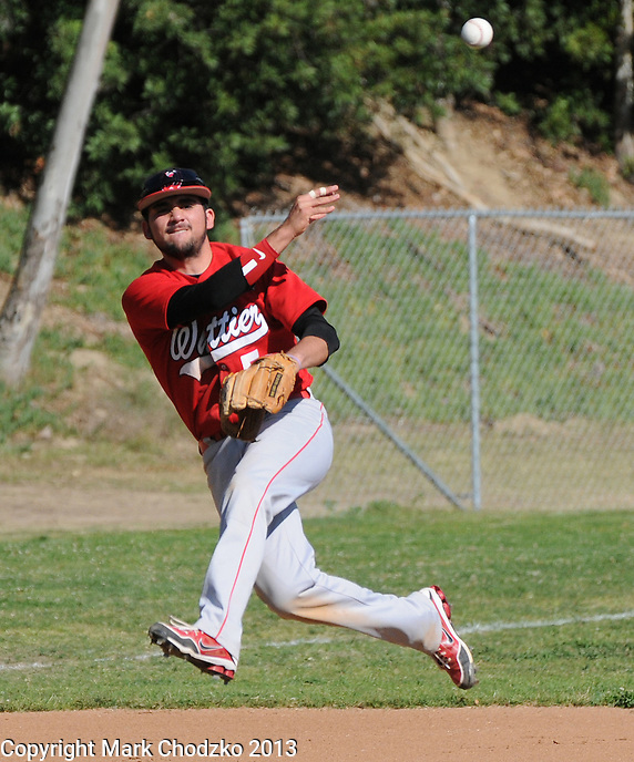 Whittier High school shortstop makes off balance throw against La Serna High school.
