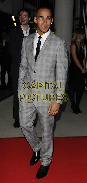Lewis Hamilton .attending the McLaren Automotive Showroom Launch at One Hyde Park, Knightsbridge, London, England, UK, June 21st 2011..full length  grey gray plaid checked check suit black shoes tie suit white shirt hand in pocket .CAP/CAN.©Can Nguyen/Capital Pictures.