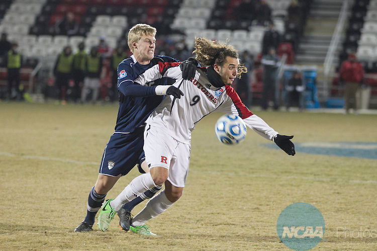 07 DEC 2013:  Midfielder Mitch Grotti (9) of Rutgers-Camden tries to maintain control of the ball in front of defender Josh Kremers (25) of Messiah during the Division III Men's Soccer Championship held at Toyota Park in San Antonio, TX.   Messiah defeated Rutgers-Camden 2-1 in double overtime for the national title.  Rudy Gonzalez/NCAA Photos