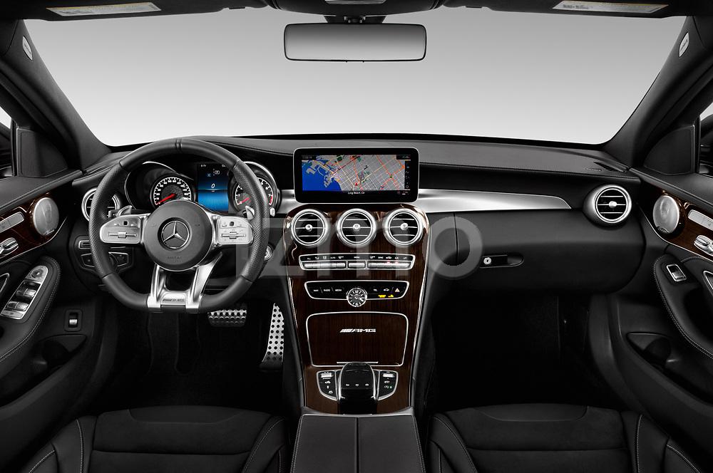 Stock photo of straight dashboard view of 2019 Mercedes Benz C-CLass 63-AMG 4 Door Sedan Dashboard