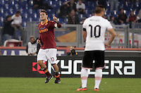 Calcio, Serie A: Roma vs Palermo. Roma, stadio Olimpico, 4 novembre 2012..AS Roma forward Francesco Totti celebrates past Palermo forward Fabrizio Miccoli, right, after scoring during the Italian Serie A football match between AS Roma and Palermo, at Rome's Olympic stadium, 4 november 2012..UPDATE IMAGES PRESS/Riccardo De Luca