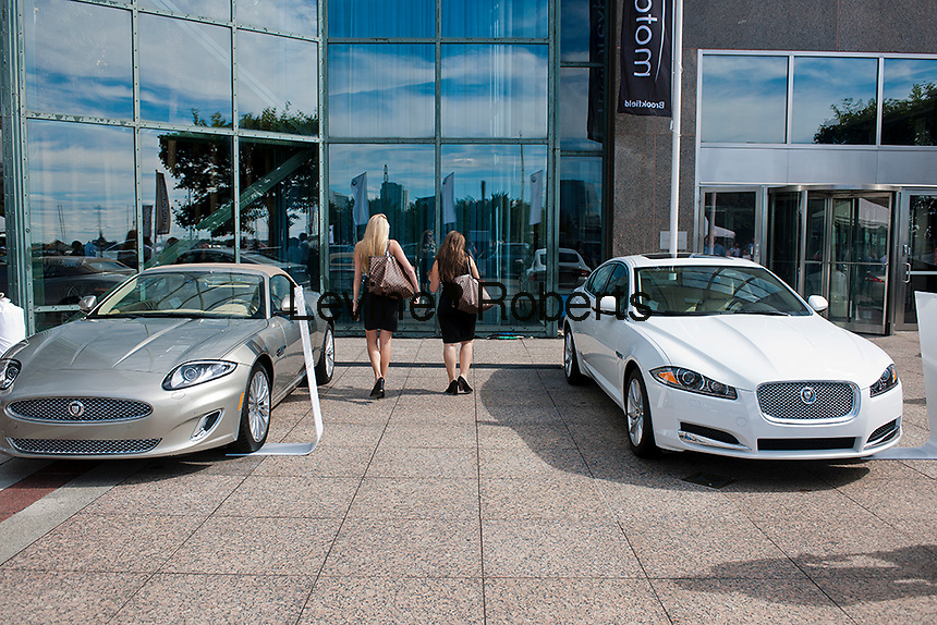 Customers examine Jaguar luxury vehicles on display at the Motorexpo in the World Financial Center in New York on Wednesday, September 19, 2012. The luxury car show hopes to attract an affluent audience, being in the World Financial Center with Goldman Sachs, American Express and the NY Mercantile Exchange in the immediate vicinity. The show is free to anyone. (© Richard B. Levine)