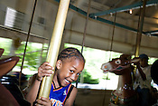 May 22, 2008. Raleigh, NC..Pullen Park entertainment.. Eric Ammons, age 5, enjoys the classic carousel, always an attraction at Pullen Park.