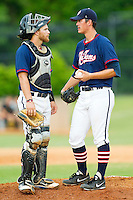 High Point-Thomasville HiToms catcher Ryan Cooper #17 (Elon) has a chat on the mound with pitcher Dylan Stoops #24 (Richmond) during the Coastal Plain League game against the Wilson Tobs at Finch Field on June 17, 2013 in Thomasville, North Carolina.  The Tobs defeated the HiToms 3-2 in 11 innings.  Brian Westerholt/Four Seam Images