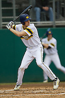 Michigan Wolverines outfielder Jackson Lamb (10) at bat during the NCAA baseball game against the Washington Huskies on February 16, 2014 at Bobcat Ballpark in San Marcos, Texas. The game went eight innings, before travel curfew ended the contest in a 7-7 tie. (Andrew Woolley/Four Seam Images)