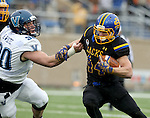 BROOKINGS, SD - DECEMBER 3:  Brady Mengarelli #44 from South Dakota State tries to sip the grasp of Bryan White #90 from Villanova during their second round playoff game Saturday afternoon at Dana J. Dykhouse Stadium in Brookings, SD. (Photo by Dave Eggen/Inertia)