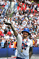 James Norwood celebrates Tranmere's victory and promotion to Division One as he holds the Trophy aloft during Newport County vs Tranmere Rovers, Sky Bet EFL League 2 Play-Off Final Football at Wembley Stadium on 25th May 2019
