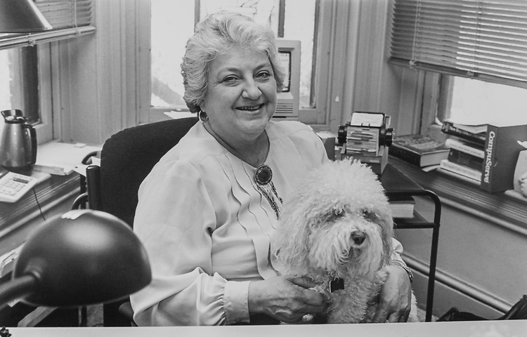 Patricia Bario, new PR person for the Hill, and Champs, her bichon, in her office, on April 21, 1994. (Photo by Laura Patterson/CQ Roll Call via Getty Images)