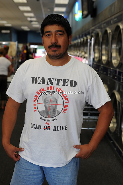 "A man in a ""Wanted Dead or Alive: Osama Bin Laden"" T-shirt poses for a portrait inside the World's Largest Laundromat in Berwyn, Illinois on July 7, 2008."