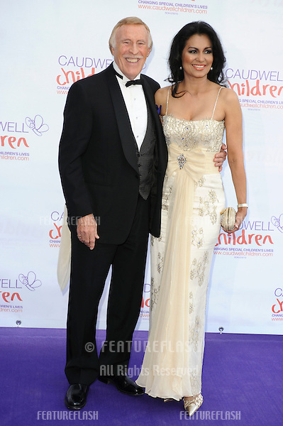 TV presenter Bruce Forsyth and wife, Wilnelia arrives for the Butterfly Ball at Battersea Evolution, London.  21/05/2010  Picture by Steve Vas/Featureflash