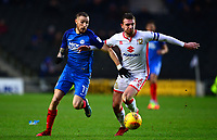 Alex Gilbey of MK Dons battles with Marcus Maddison of Peterborough during the Sky Bet League 1 match between MK Dons and Peterborough at stadium:mk, Milton Keynes, England on 30 December 2017. Photo by Bradley Collyer / PRiME Media Images.