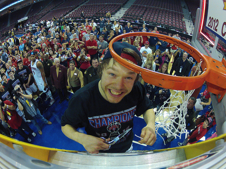 March 5, 2012; Las Vegas, NV, USA; Saint Mary's Gaels guard Matthew Dellavedova (4) celebrates cutting the net against the Gonzaga Bulldogs during the WCC Basketball Championships at Orleans Arena.