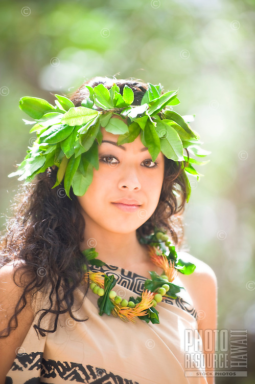 Young hula dancer with maile lei