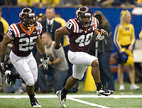 Wiley Brown of Virginia Tech celebrates after making a huge play against Michigan during Sugar Bowl game at Mercedes-Benz SuperDome in New Orleans, Louisiana on January 3rd, 2012.    Michigan defeated Virginia Tech, 23-20 in first overtime.