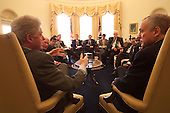 United States President Bill Clinton meets with Congressional leaders on guns in the Oval Office of the White House in Washington, D.C. on March 7, 2000. Seated next to the President: U.S. Senator Orrin Hatch (Republican of Utah). Seated in background are the following members of Congress and White House staff (left to right): U.S. Senator Patrick Leahy (Democrat of Vermont); Bruce Reed, Assistant to the President and Director of the Domestic Policy Council; Charles Brain, Assistant to the President and Director for Legislative Affairs; U.S. Representative Henry Hyde (Republican of Illinois); John Podesta, White House Chief of Staff; and U.S. Representative John Conyers (Democrat of Michigan)..Mandatory Credit: William Vasta / White House via CNP..