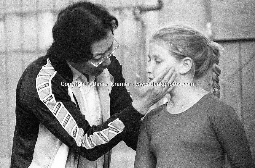 At first, when he came to the Bay Area from China, the other teachers at the school thought Lu Yi would be a very strict disciplinarian. Shown here, he administers a little TLC to a pupil in 1994.<br /> The San Francisco School of Circus Arts is the only school of its kind in the United States. Its students range in age from 3 to mid-40s. The school trains children and adults in a variety of circus art forms, such as the Flying Trapeze or the Advanced Chinese Acrobatics, which is taught by Master Trainer Lu Yi. Mr. Yi was China's premiere acrobatic teacher before he immigrated to the United States in 1986.