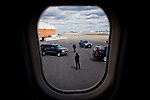 Secret Service agents stand watch outside GOP presidential candidate Gov. Mitt Romney's chartered plane in Newark, New Jersey, June 26, 2012.