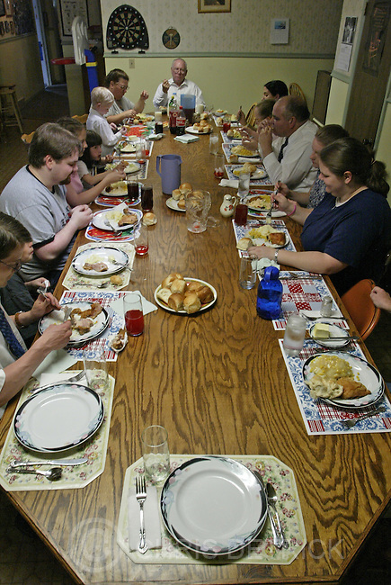 Salt Lake City,Utah--6/12/2005- .**ZONES**.Members of the Rushton family gather together for dinner Sunday afternoon.  .Photo By: Chris Detrick /Salt Lake Tribune.