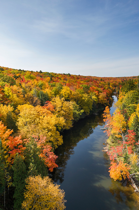 Aerial view of a river with fall color in Michigan during autumn.