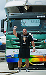 HAINAN ISLAND, CHINA - AUGUST 23:  Brian Shaw of USA competes at the Truck Pull event during the World's Strongest Man competition at Serenity Marina on August 23, 2013 in Hainan Island, China.  Photo by Victor Fraile