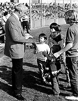New York Yankee great Joe DiMaggio signing autographs for kids at University of California baseball diamond in Berkeley, Ca (1974 photo/Ron Riesterer)