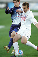 Maryland's David Glaudemans (3) holds off SMU's Paulo da Silva. The University of Maryland defeated Southern Methodist University 4-1 in the NCAA Semifinal at SAS Stadium in Cary, North Carolina, Friday, December 9, 2005.