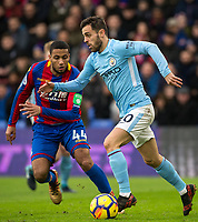 Bernardo Silva of Manchester City & Jairo Riedewald of Crystal Palace during the Premier League match between Crystal Palace and Manchester City at Selhurst Park, London, England on 31 December 2017. Photo by Andy Rowland.