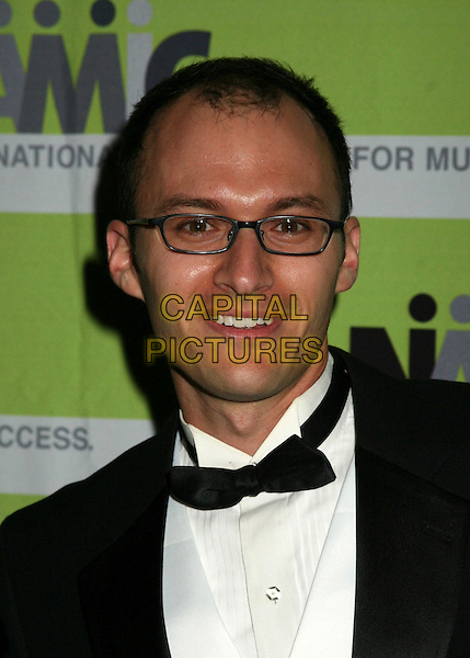 ERIC SCHWARTZ.12th Annual NAMIC Vision Awards, Beverly Hills, California, USA..April 18th, 2006.Photo: Byron Purvis/AdMedia/Capital Pictures.Ref: BP/ADM.headshot portrait glasses bow tie.www.capitalpictures.com.sales@capitalpictures.com.© Capital Pictures.