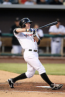Trent Oeltjen #10 of the Albuquerque Isotopes plays in a Pacific Coast League game against the Omaha Storm Chasers at Isotopes Park on May 4, 2011  in Albuquerque, New Mexico. .Photo by:  Bill Mitchell/Four Seam Images.