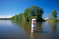 Buoy in Pocomoke River, a tributary of the Chesapeake Bay, warns boaters that the waters are infected with toxics from pfiesteria piscicada. Contact with the water was prohibited during parts of late summer and fall of 1997. Maryland, Chesapeake Bay.