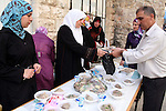 Palestinians take part in the Traditional Food Festival in the West Bank city of Hebron on October 19,2010. The festival was organized by Hebron rehabilitation committee and this festival is a part of Amar Ya Baladna camping to support the old city of Hebron. Photo by Najeh Hashlamoun