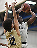 Jonathan Dean #3 of Westbury, right, shoots a jumper as Derrick Ruffin #12 of Baldwin looks to contest the shot during the Nassau County varsity boys basketball Class AA semifinals at SUNY Old Westbury on Tuesday, Feb. 28, 2017. Dean scored a team-high 18 points in Westbury's 48-45 win.