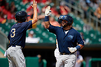 Mobile BayBears Bo Way (3) high fives Julian Leon (20) after hitting a home run during a Southern League game against the Montgomery Biscuits on May 2, 2019 at Riverwalk Stadium in Montgomery, Alabama.  Mobile defeated Montgomery 3-1.  (Mike Janes/Four Seam Images)