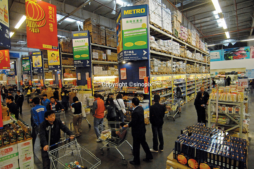 Chinese consumers buy imported food at a new metro supermarket in Kunming city, China. The 8,000 square meter super-store is attracting more and more customers who are buying imported food in bulk as their tastes are quickly changing and becoming more sophisticated.  As the chinese grow richer they<br />are consuming more and more food and are being partially blamed for mopping up excess food on the world food markets resulting in the world food crisis and increase in cost of staple products.<br />27 Apr 2008