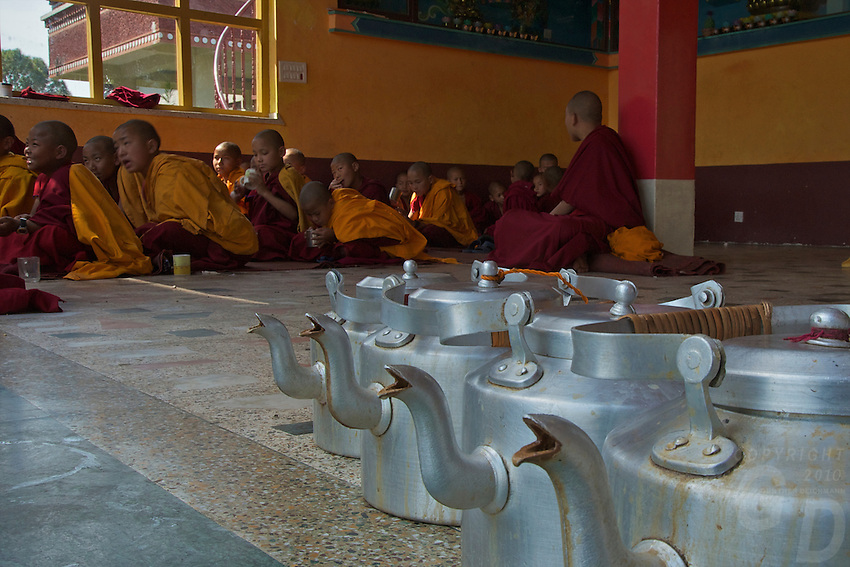 Masala tea Pots and Buddhist Tibetan Monks during a Prayer and lecture at the Kopan Monastery Kathmandu