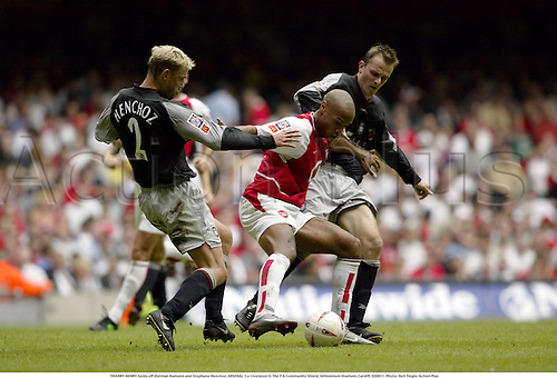 THIERRY HENRY holds off Dietmar Hamann and Stephane Henchoz, ARSENAL 1 v Liverpool 0, The F A Community Shield, Millennium Stadium, Cardiff, 020811. Photo: Neil Tingle/Action Plus...soccer association football.2002.english league.charity.hold holding