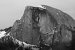 """Half Dome Close Up"" Black and White. Yosemite National Park, California. This photograph was taken a few minutes after the ""Sunset 2"" image. I have posted a series of three photographs of this sunset along with an artistic version where I smoothed out the texture of the rock. Capturing Half Dome at sunset really showcases the spectacular colors of its monolithic face.  45,000 people a year climb the famous cables to the summit. I took this picture on my way back down from hiking Yosemite Falls Waterfall."