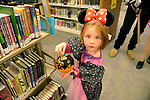 Rene Mellow, 4, takes her Halloween art home from the Carson City Library Monday, Oct. 27, 2014. As part of the library's Halloween festivities, dozens of children decorated pumpkins or gourds and took part in a costume contest.
